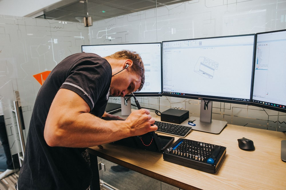 Man working on electronic device